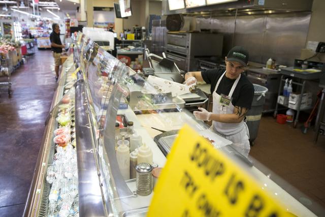 Chris Vindell prepares a pastrami sandwich for a customer at Glazier's food marketplace on Thursday, Nov. 10, 2016, in Las Vegas. Erik Verduzco/Las Vegas Review-Journal Follow @Erik_Verduzco