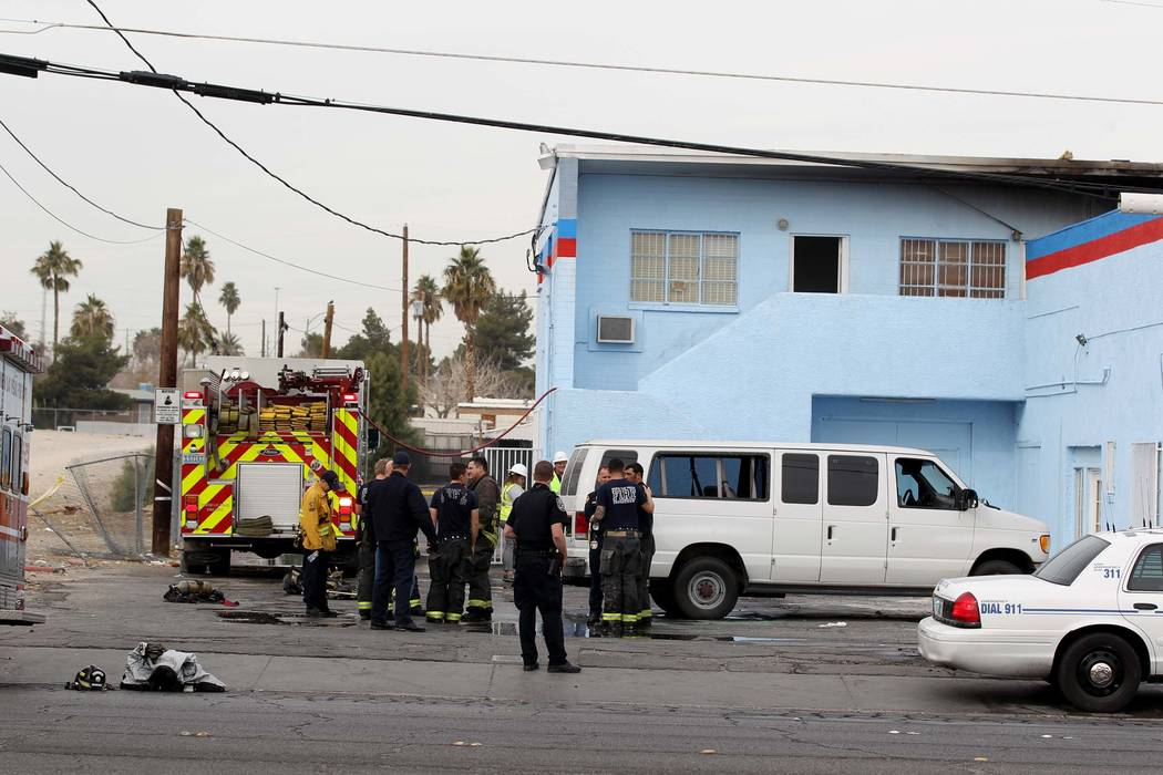 North Las Vegas firefighters investigate a deadly fire in an abandoned building at 2055 Las Vegas Blvd. North near East Lake Mead Boulevard, Tuesday, Jan. 2, 2018. (K.M. Cannon/Las Vegas Review-Jo ...