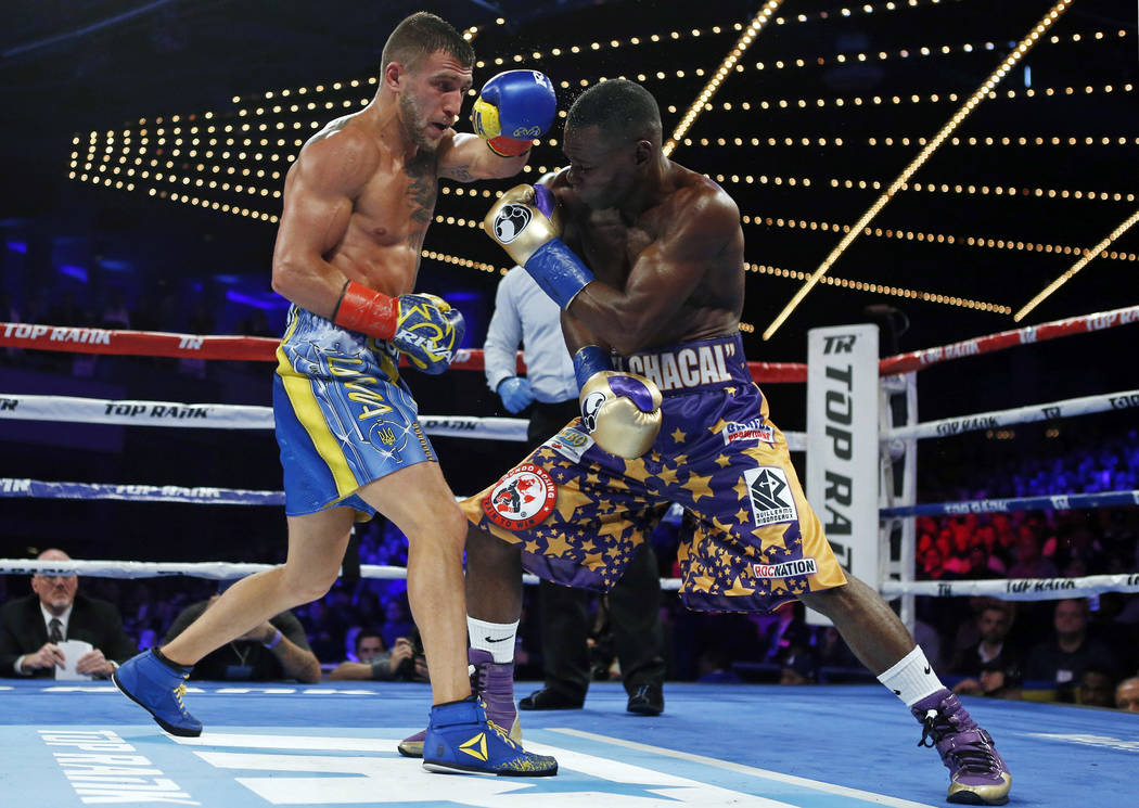 Vasyl Lomachenko, left, of Ukraine, punches Guillermo Rigondeaux during the sixth round of a WBO junior lightweight title boxing match Saturday, Dec. 9, 2017, in New York. Lomachenko won the bout. ...