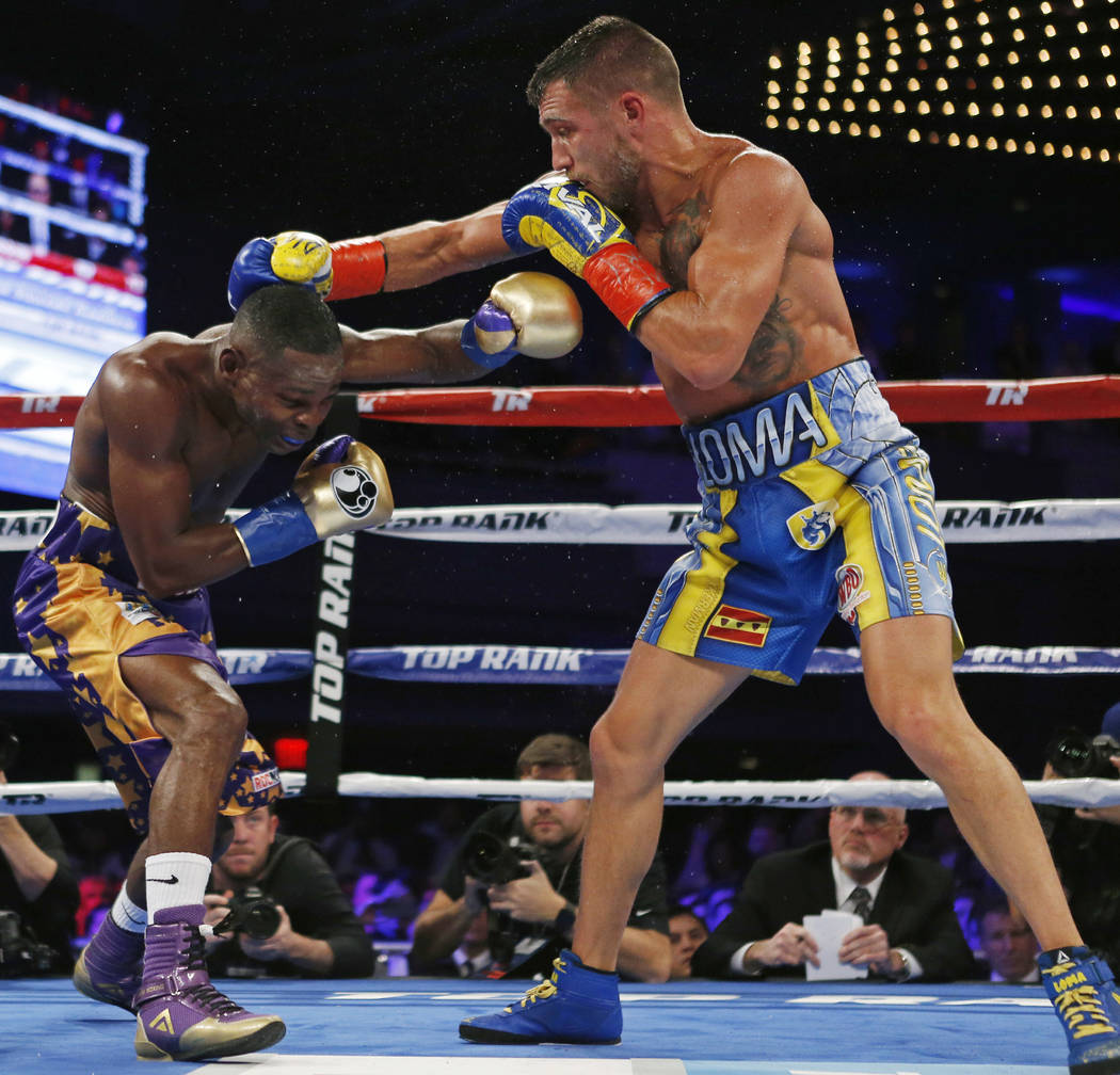 Vasyl Lomachenko, right, of Ukraine, tries to hit Guillermo Rigondeaux with a right during the sixth round of a WBO junior lightweight title boxing match Saturday, Dec. 9, 2017, in New York. Lomac ...