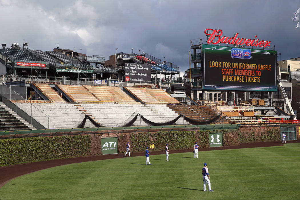 In this May 11, 2015, file photo, construction continues on the right field bleachers at Wrigley Field before a baseball game between the Chicago Cubs and New York Mets in Chicago. A lawsuit was f ...