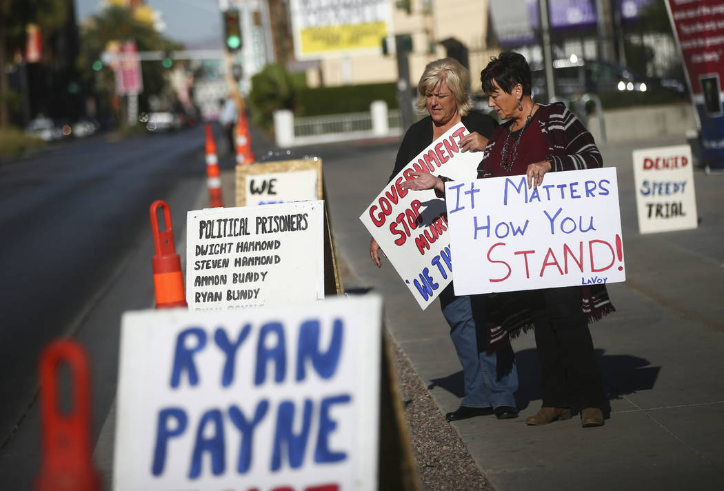 Lillie Spencer, left, and Margaret Houston hold signs in support of the Bundy family and others outside the in Lloyd George U.S. Courthouse in downtown Las Vegas on Tuesday, Nov. 14, 2017. Opening ...