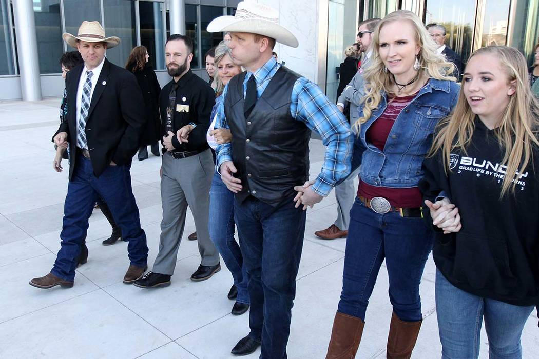 Carol Bundy, from left, Ammon Bundy, Ryan Payne, Jeanette Finicum, Ryan Bundy, his wife, Angie, and his daughter, Jamie, walk out of the Lloyd George U.S. Courthouse Wednesday, Dec. 20, 2017, afte ...