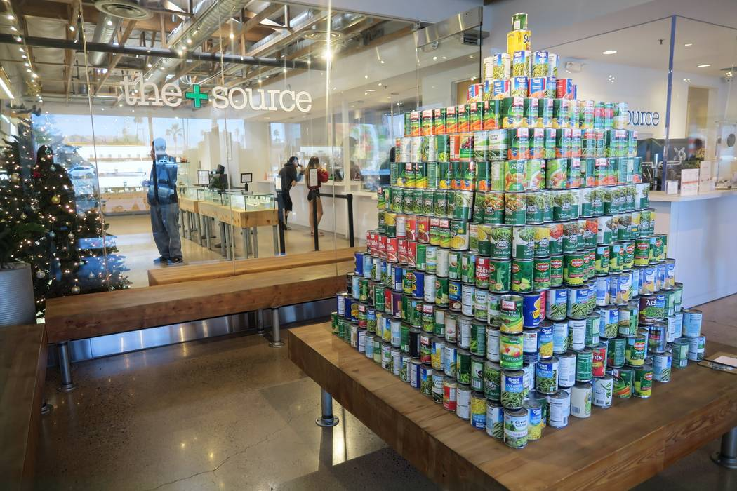A pyramid of canned foods donated as part of a food drive at The+Source Dispensary in Las Vegas. The business wound up receiving more than 156,000 pounds of non-perishable food that was then donat ...