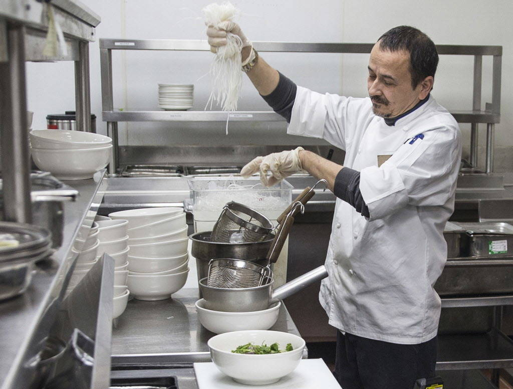 Chef Thierry Mai prepares pho in the kitchen at The Coffee Shop on Friday, January 5, 2018, at Treasure Island hotel-casino, in Las Vegas. Benjamin Hager Las Vegas Review-Journal @benjaminhphoto