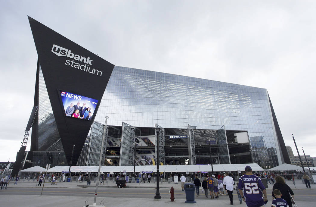 Fans enter U.S. Bank Stadium before an NFL preseason football game between the Minnesota Vikings and the San Francisco 49ers, Sunday, Aug. 27, 2017, in Minneapolis. (AP Photo/Bruce Kluckhohn)