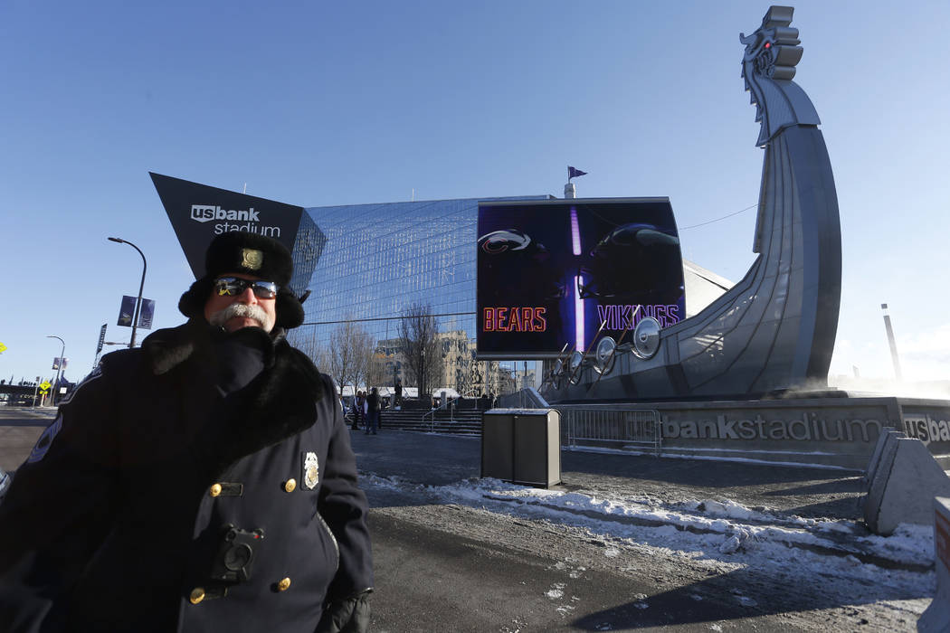A police officer stands outside U.S. Bank Stadium before an NFL football game between the Minnesota Vikings and the Chicago Bears, Sunday, Dec. 31, 2017, in Minneapolis. (AP Photo/Bruce Kluckhohn)