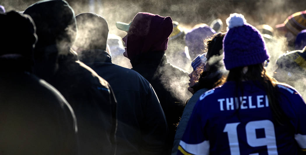 Fans stand in line in subzero temperatures to enter U.S. Bank Stadium to watch an NFL football game between the Chicago Bears and Minnesota Vikings in Minneapolis. (Carlos Gonzalez/Star Tribune vi ...