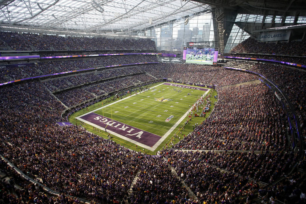 FILE - In this Sept. 24, 2017 file photo, fans cheer in U.S. Bank Stadium during the second half of an NFL football game between the Minnesota Vikings and the Tampa Bay Buccaneers in Minneapolis.  ...