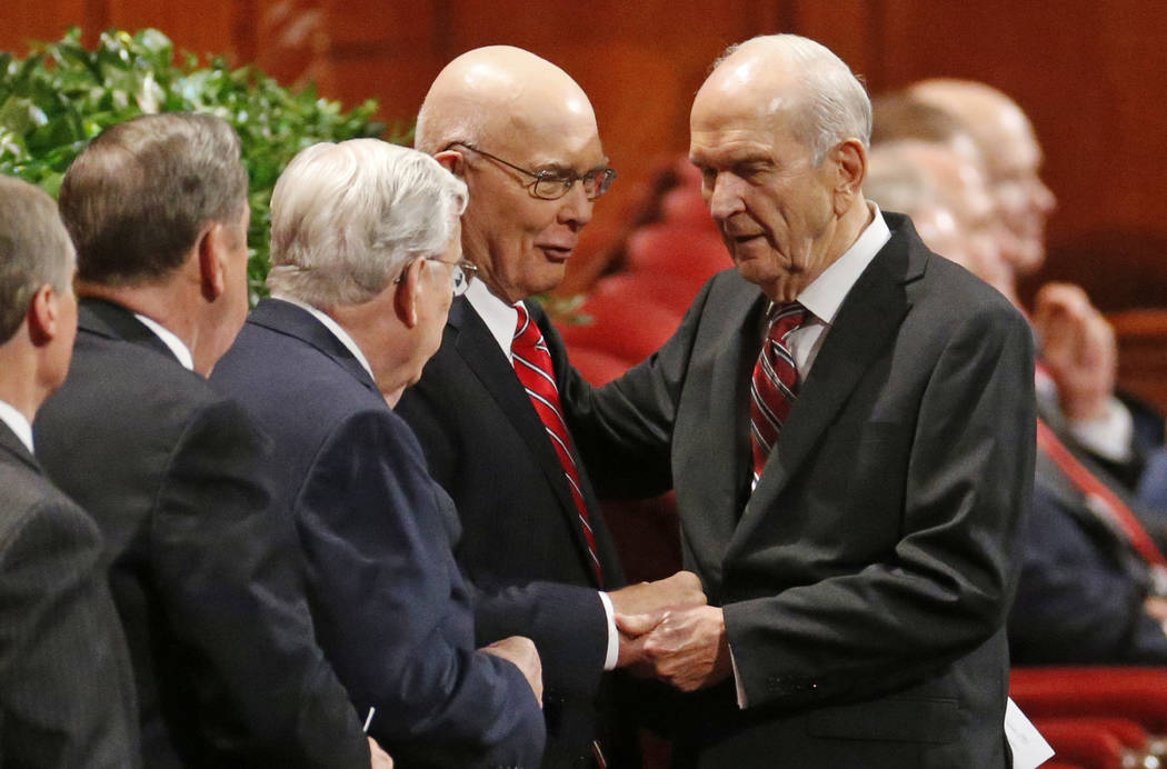 Russell M. Nelson, right, president of the Quorum of the Twelve Apostles, right, greets members of the Quorum on Sept. 30, 2017, before the start of the morning session of the two-day Mormon churc ...