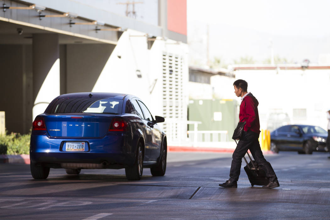 A person waits for a ride outside of the closed Lucky Dragon hotel-casino in Las Vegas, Thursday, Jan. 4, 2018. Erik Verduzco/Las Vegas Review-Journal