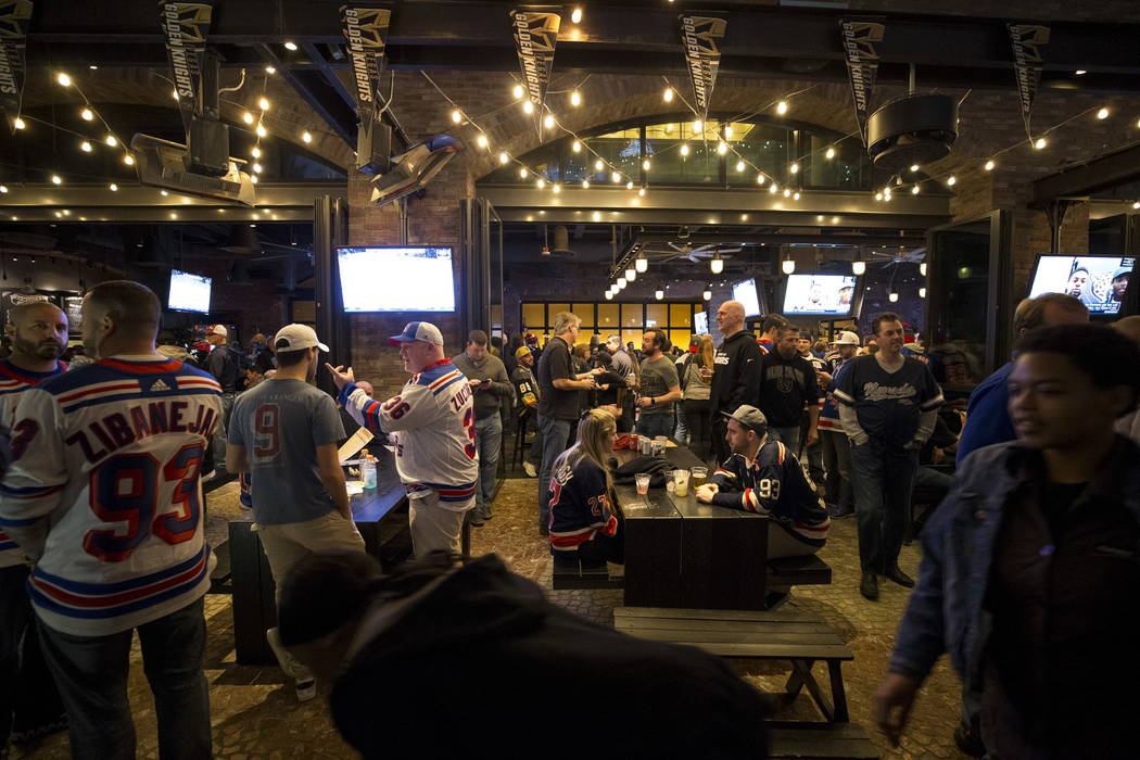 Hockey fans hangout at Beerhaus at The Park ahead of NHL hockey game between the Vegas Golden Knights and the New York Rangers at the T-Mobile Arena in Las Vegas, Sunday, January 07, 2018. Richard ...