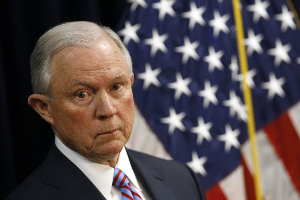Attorney General Jeff Sessions listens to a reporter's question during a news conference in Baltimore, Tuesday, Dec. 12, 2017, to announce efforts to combat the MS-13 street gang with law enforcem ...