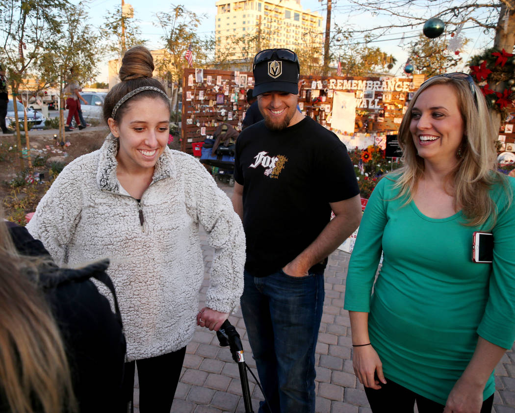 Katrina Hannah, 21, of La Verne, Calif., , left, visits with Austin Stout, of Las Vegas, who carried her to safety after she was shot at the Route 91 Harvest festival and his wife Tara during a vi ...