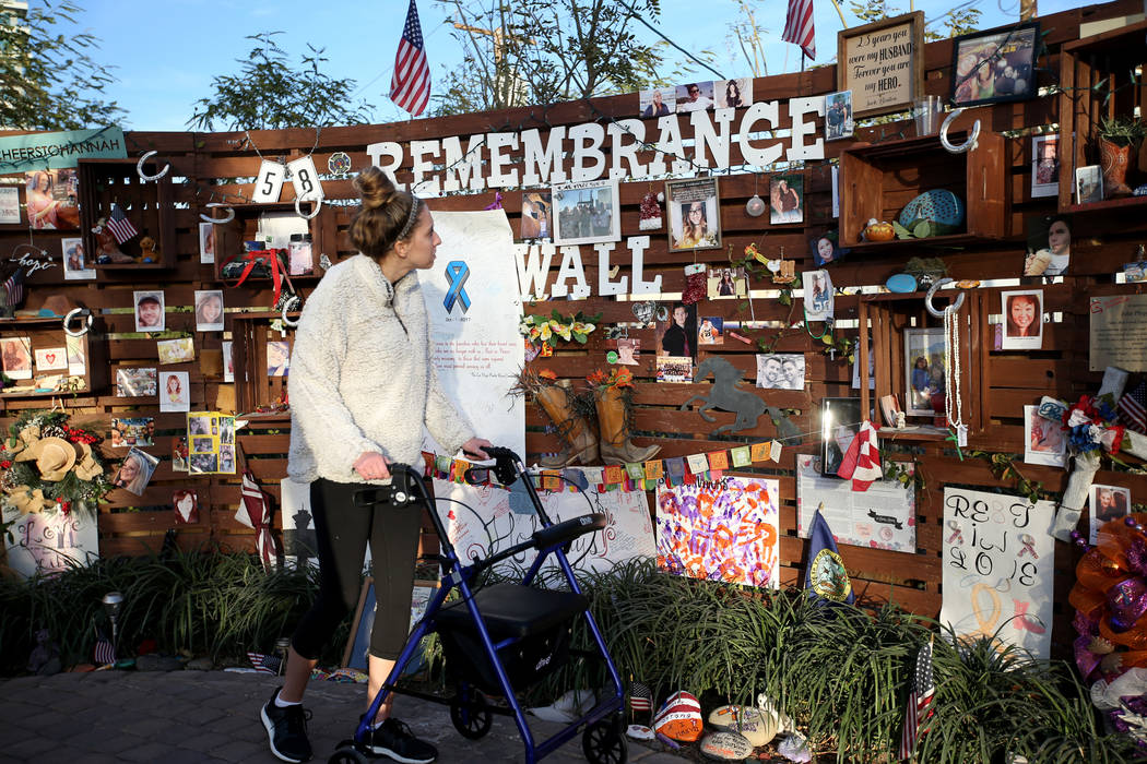 Katrina Hannah, 21, of La Verne, Calif., who was shot at the Route 91 harvest festival country music concert, visits the Remembrance Wall at the Healing Garden in downtown Las Vegas Thursday, Jan. ...
