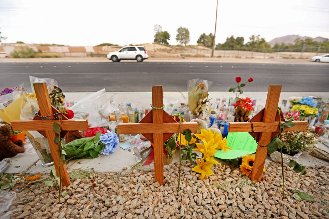 A car passes a memorial site on Wednesday, Oct. 18, 2017, where three juveniles between the ages of 12 and 15 were hit by a car on Sept. 30 on Desert Inn Road and east of Nellis Boulevard in Las V ...