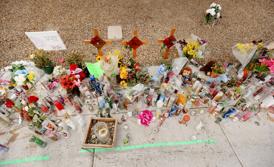 Three crosses with the names of three juveniles between the ages of 12 and 15 that were hit by a car on Sept. 30 on Desert Inn Road and east of Nellis Boulevard, at a memorial site  Wednesday, Oct ...