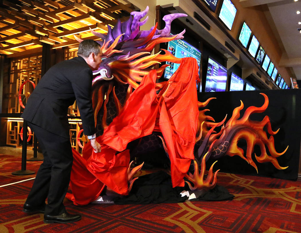 Boyd Gaming vice president of corporate communications David Strow unveils a life-size Kylin Lantern at the Gold Coast in Las Vegas, Thursday, Jan. 4, 2018. (Heidi Fang Las Vegas/Review-Journal) @ ...