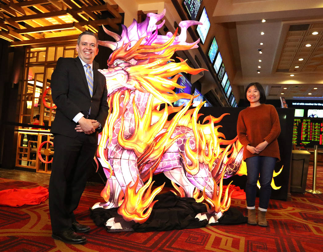 Sichuan Tianyu Culture Communication Co., Ltd. event manager Huiyuan Liu, right, and Boyd Gaming vice president of corporate communications David Strow present a life-size Kylin Lantern at the Gol ...