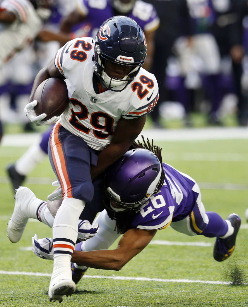 Chicago Bears running back Tarik Cohen (29) is tackled by Minnesota Vikings cornerback Trae Waynes (26) during the second half of an NFL football game, Sunday, Dec. 31, 2017, in Minneapolis. (AP P ...