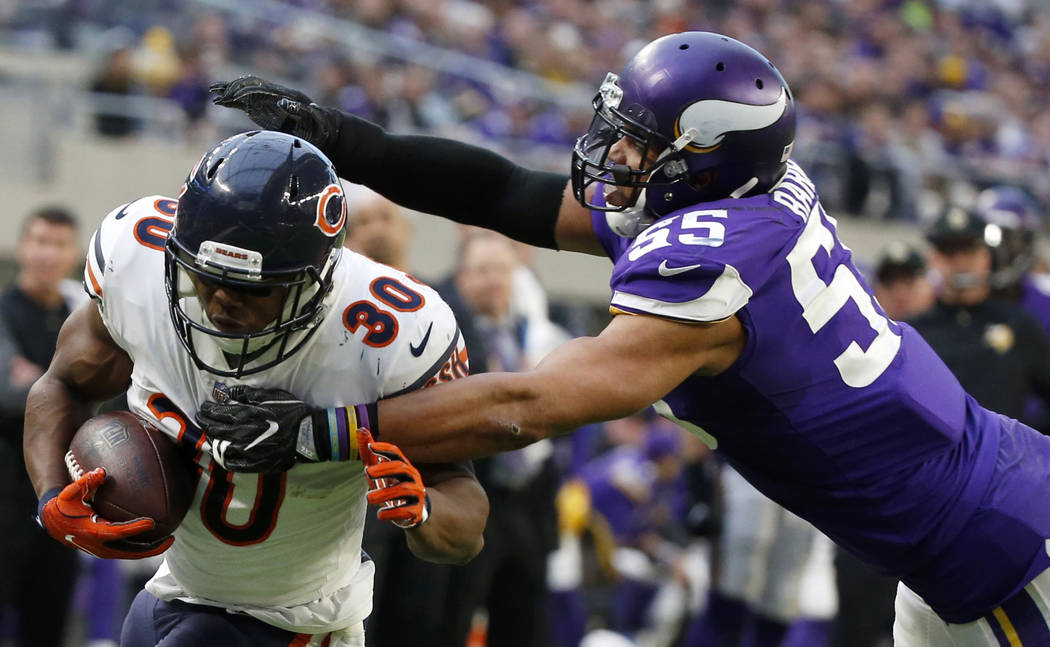 Chicago Bears running back Benny Cunningham (30) runs from Minnesota Vikings outside linebacker Anthony Barr (55) during the second half of an NFL football game, Sunday, Dec. 31, 2017, in Minneapo ...