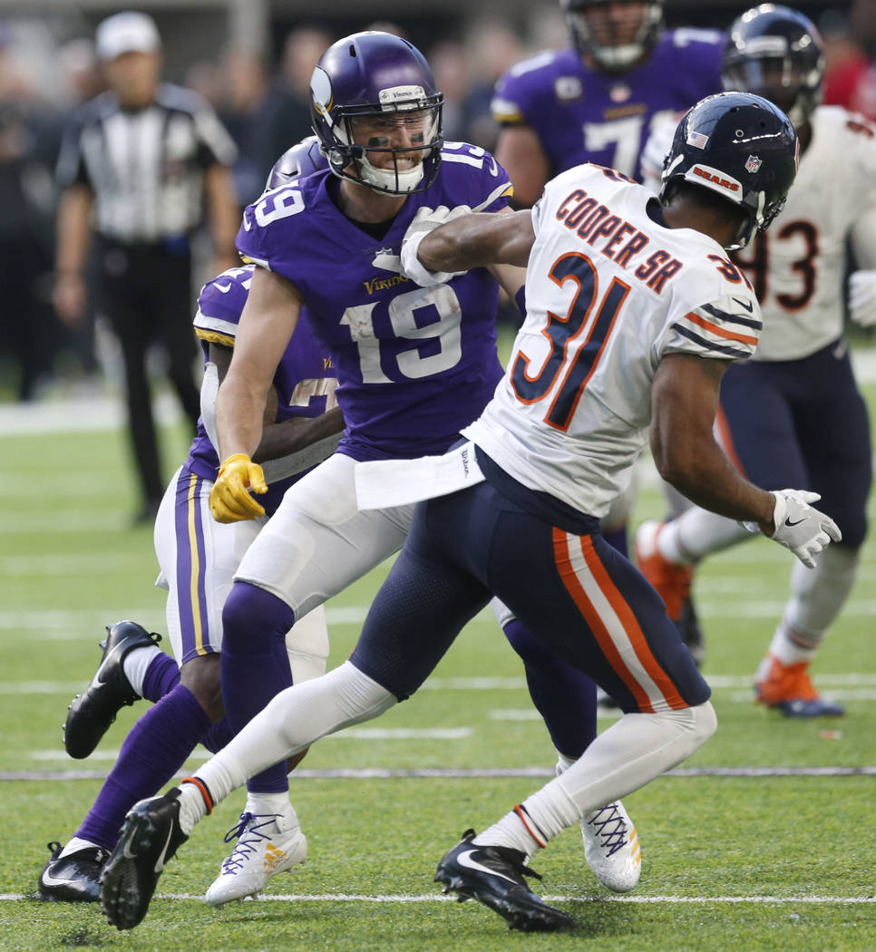 Minnesota Vikings wide receiver Adam Thielen (19) blocks Chicago Bears cornerback Marcus Cooper (31) during the second half of an NFL football game, Sunday, Dec. 31, 2017, in Minneapolis. (AP Phot ...