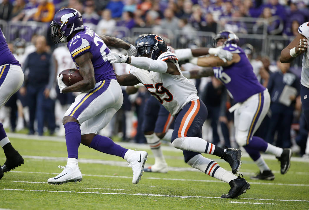 Minnesota Vikings running back Latavius Murray (25) runs from Chicago Bears inside linebacker Danny Trevathan (59) during the second half of an NFL football game, Sunday, Dec. 31, 2017, in Minneap ...