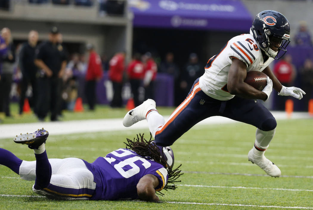 Chicago Bears running back Tarik Cohen (29) is tackled by Minnesota Vikings cornerback Trae Waynes (26) during the second half of an NFL football game, Sunday, Dec. 31, 2017, in Minneapolis. The V ...