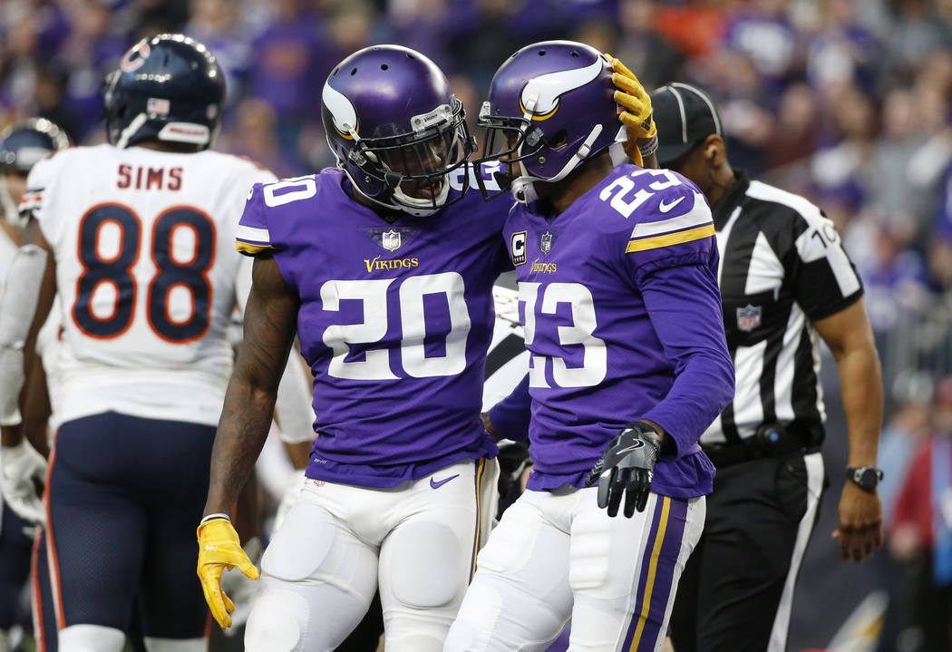 Minnesota Vikings cornerback Mackensie Alexander (20) celebrates with teammate Terence Newman (23) during the second half of an NFL football game against the Chicago Bears, Sunday, Dec. 31, 2017,  ...