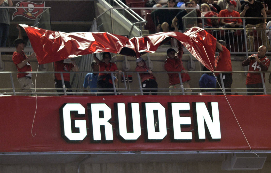 Former Tampa Bay Buccaneers head coach Jon Gruden's name is uncovered after being inducted into the team's Ring of Honor during the halftime of an NFL football game against the Atlanta Falcons Mon ...