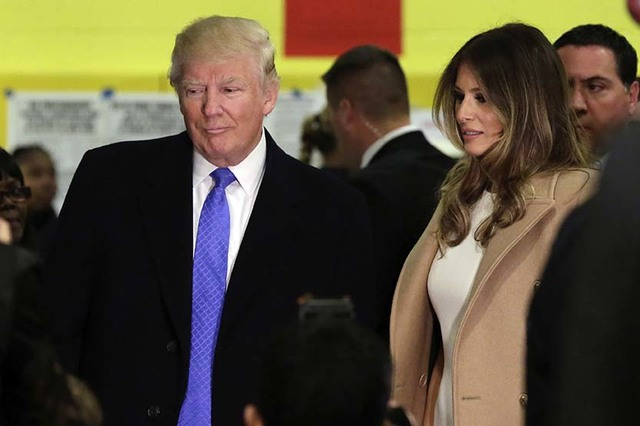 Republican presidential candidate Donald Trump and his wife Melania prepare to leave after voting, in New York, Tuesday, Nov. 8, 2016. (AP Photo/Richard Drew)
