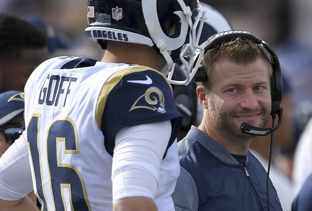 Los Angeles Rams head coach Sean McVay talks with quarterback Jared Goff during the first half of an NFL football game against the Philadelphia Eagles Sunday, Dec. 10, 2017, in Los Angeles. (AP Ph ...