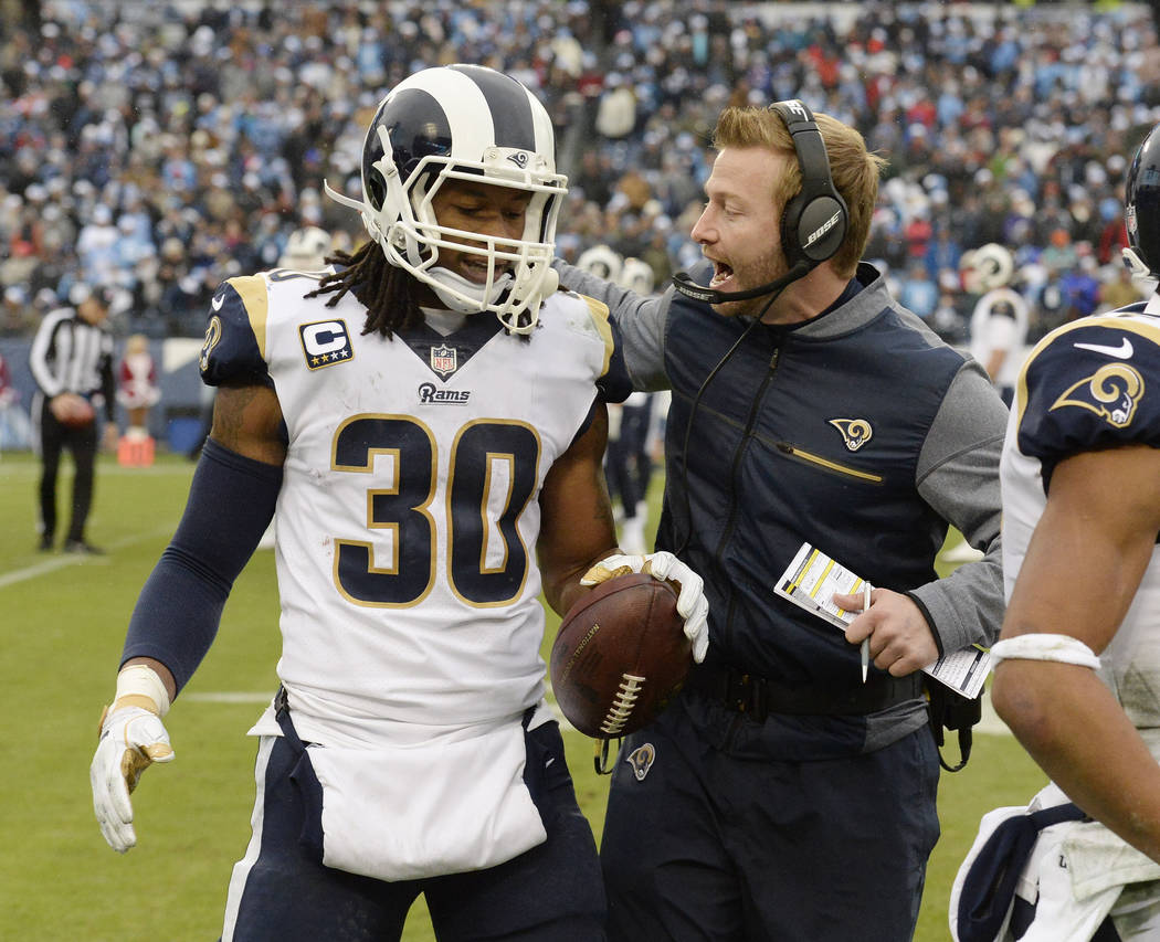 Los Angeles Rams running back Todd Gurley (30) is congratulated by head coach Sean McVay after Gurley scored a touchdown against the Tennessee Titans on an 80-yard pass reception in the first half ...