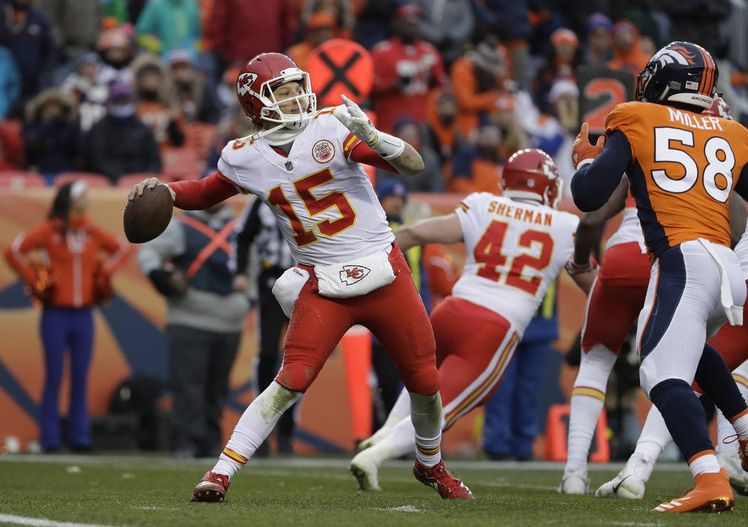 Kansas City Chiefs quarterback Patrick Mahomes (15) throws against the Denver Broncos during the second half of an NFL football game Sunday, Dec. 31, 2017, in Denver. (AP Photo/Jack Dempsey)