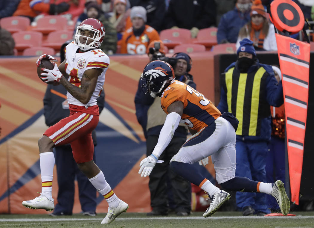 Kansas City Chiefs wide receiver Demarcus Robinson (14) makes a catch against the Denver Broncos during the second half of an NFL football game Sunday, Dec. 31, 2017, in Denver. (AP Photo/Jack Dem ...