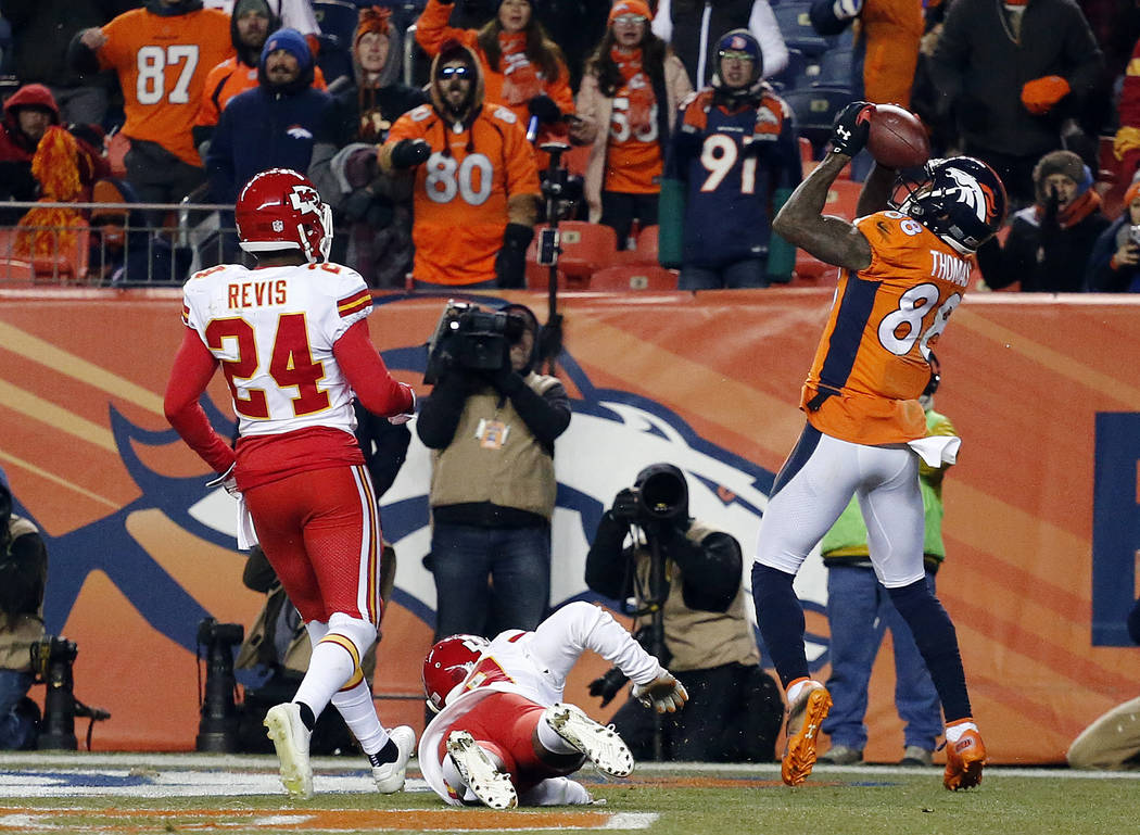 Denver Broncos wide receiver Demaryius Thomas (88) catches a touchdown against the Kansas City Chiefs during the second half of an NFL football game Sunday, Dec. 31, 2017, in Denver. (AP Photo/Jac ...