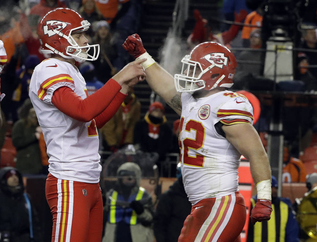 Kansas City Chiefs' Harrison Butker, left, celebrates with teammate Anthony Sherman after Butker's game-winning field goal against the Denver Broncos during an NFL football game Sunday, Dec. 31, 2 ...