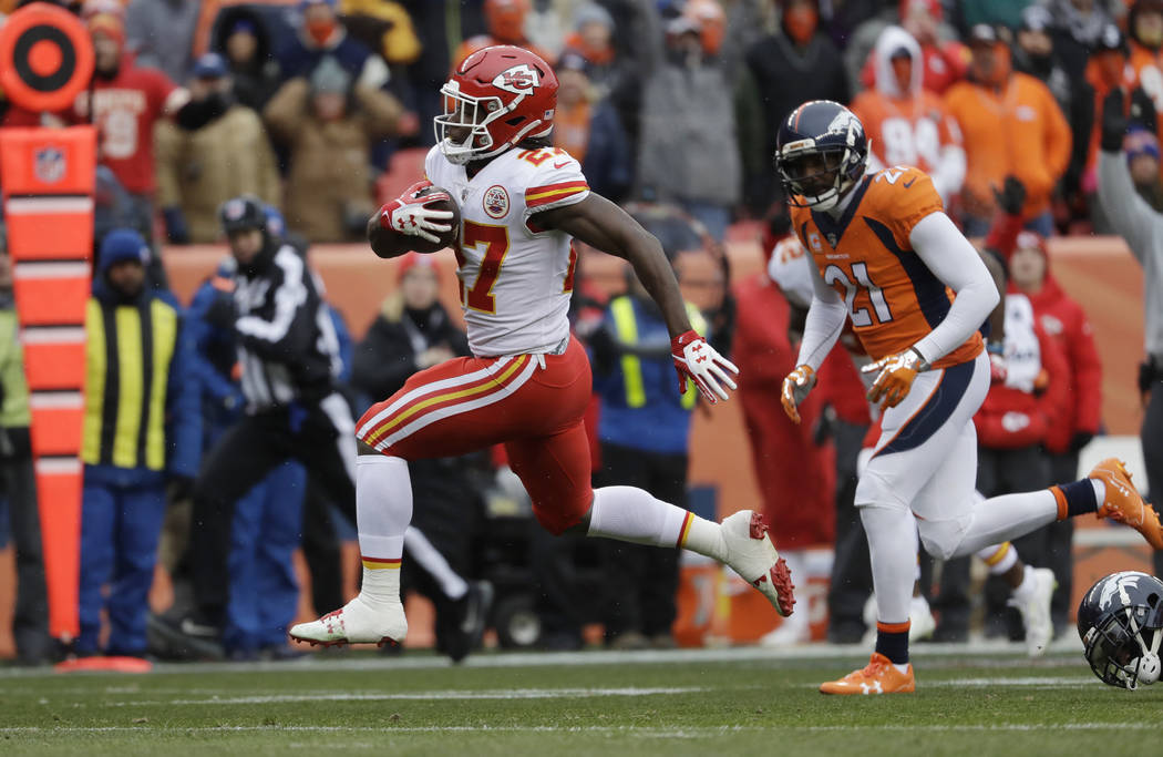 Kansas City Chiefs running back Kareem Hunt (27) runs for a touchdown against the Denver Broncos during the first half of an NFL football game Sunday, Dec. 31, 2017, in Denver. (AP Photo/Jack Dempsey)