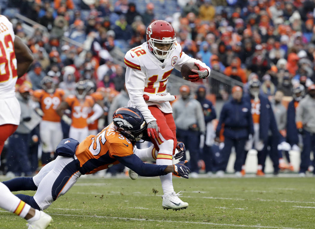 Kansas City Chiefs wide receiver Albert Wilson (12) runs against the Denver Broncos' Dymonte Thomas (35) during the first half of an NFL football game Sunday, Dec. 31, 2017, in Denver. (AP Photo/J ...