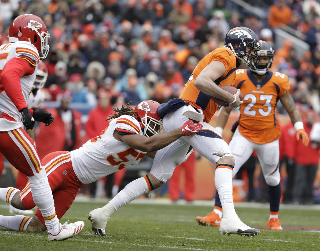 Kansas City Chiefs wide receiver Albert Wilson, right, is tackled by Kansas City Chiefs inside linebacker Ramik Wilson during the first half of an NFL football game Sunday, Dec. 31, 2017, in Denve ...
