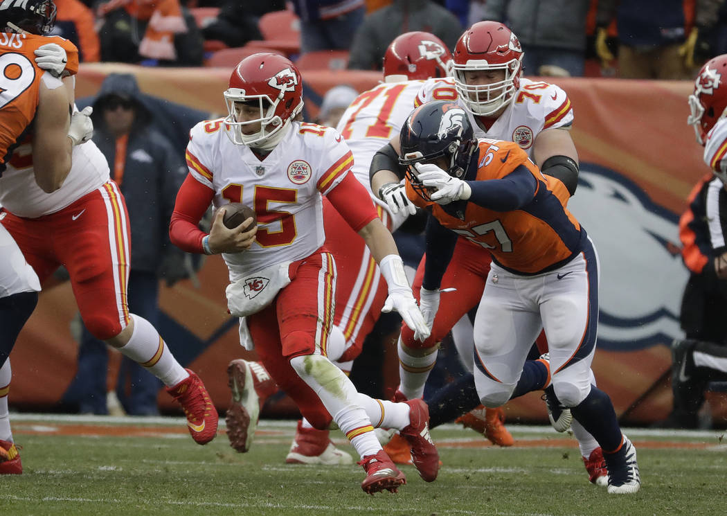 Kansas City Chiefs quarterback Patrick Mahomes (15) carries against the Denver Broncos during the first half of an NFL football game Sunday, Dec. 31, 2017, in Denver. (AP Photo/Jack Dempsey)