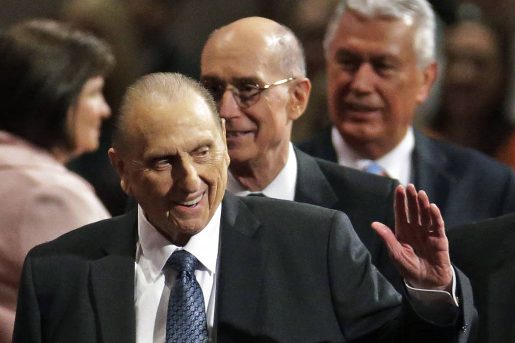 FILE - In this April 4, 2015, file photo, President Thomas S. Monson, of The Church of Jesus Christ of Latter-day Saints, waves to the audience during the opening session of the Mormon church conf ...