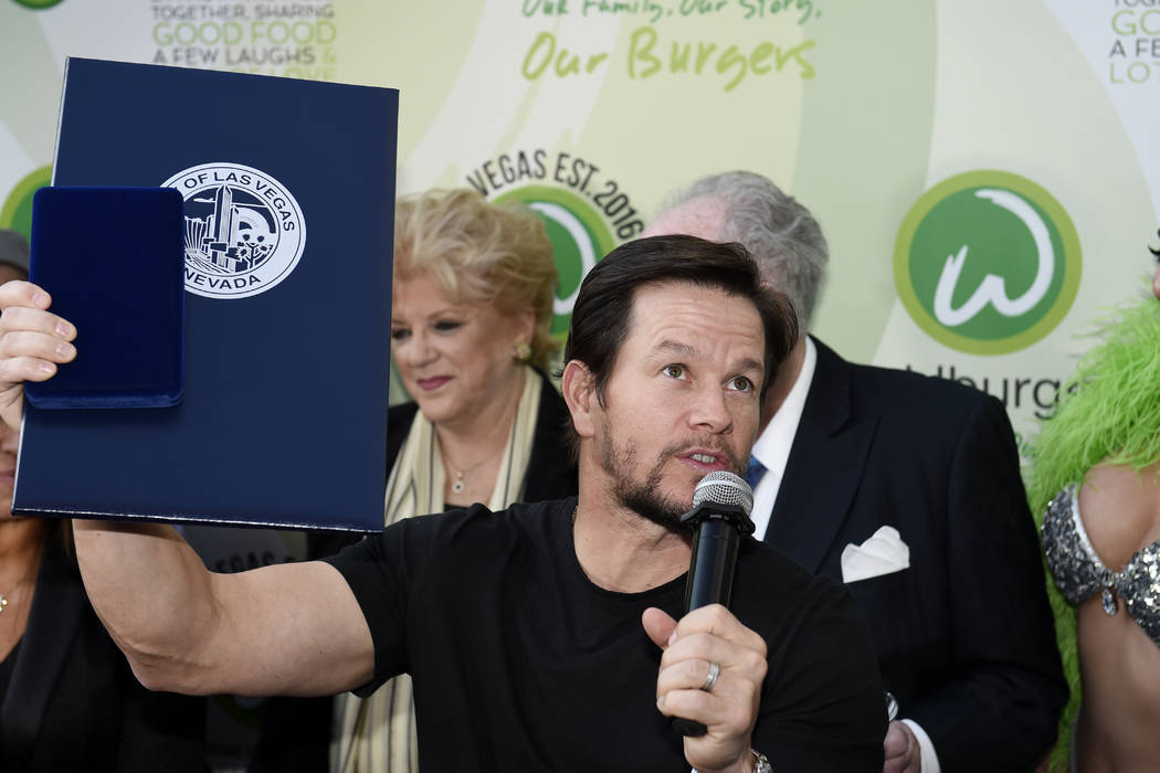Mark Wahlberg talks to fans after receiving a key to the city as he arrives at a VIP event at Wahlburgers Las Vegas in the Grand Bazaar Shops at Bally's Tuesday, March 28, 2017. Sam Morris/Las Veg ...