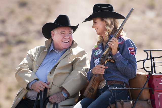 Michael Gaughan, left, owner of the South Point Hotel and Casino in Las Vegas, and Champion Barrel Racer Sherry Cervi share a laugh during a promotional photo shoot for the National Finals Rodeo.  ...