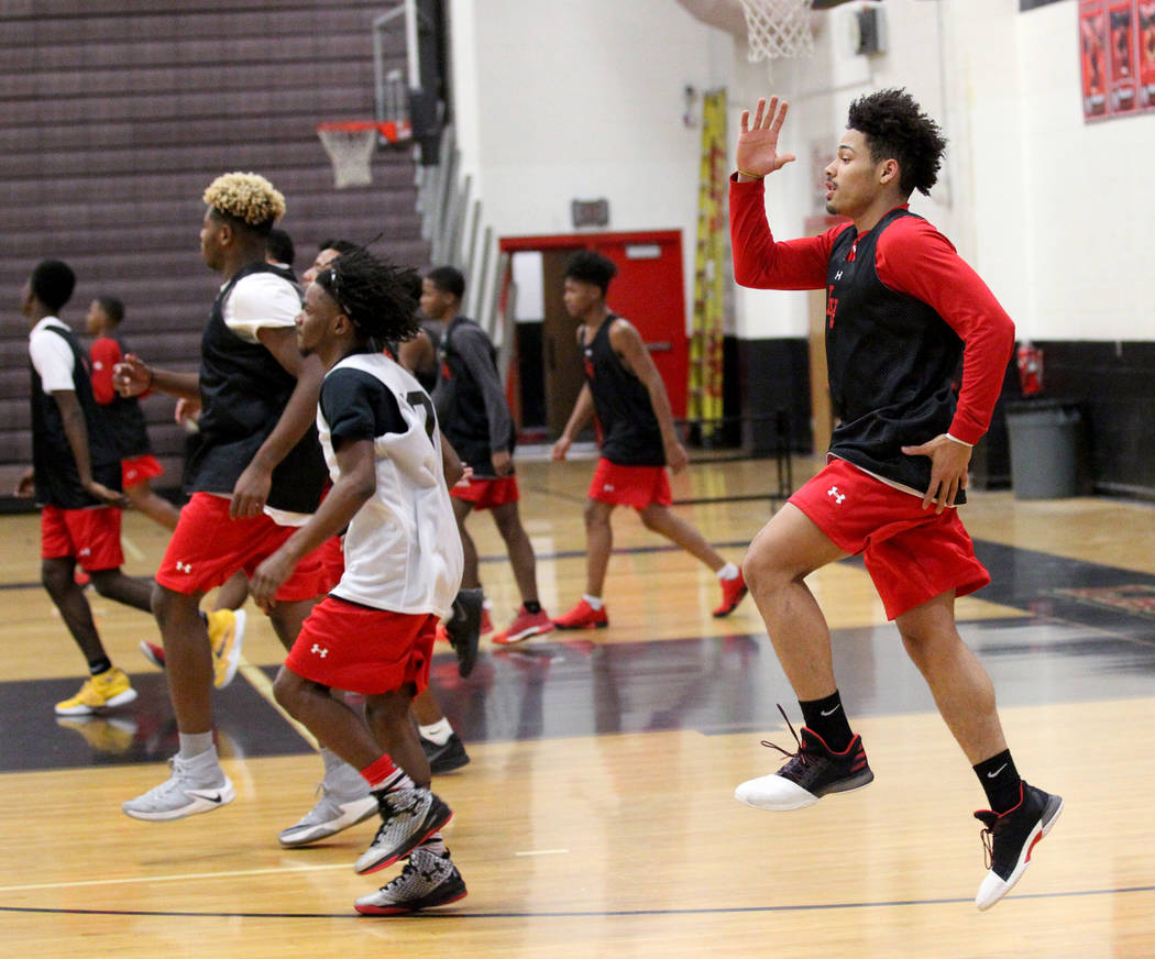 Las Vegas High School point guard Donovan Joyner, right, runs a warm-up drill with his team during practice Monday, Jan. 8, 2018. The 5-foot-9 Joyner is one of the top players in the Southern Neva ...