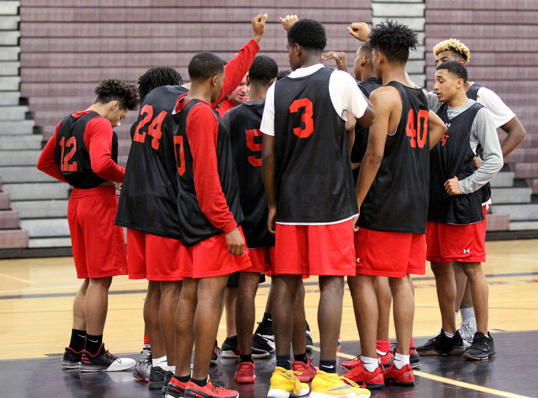 Las Vegas High School point guard Donovan Joyner, left, huddles with his team during practice Monday, Jan. 8, 2018. The 5-foot-9 Joyner is one of the top players in the Southern Nevada. K.M. Canno ...