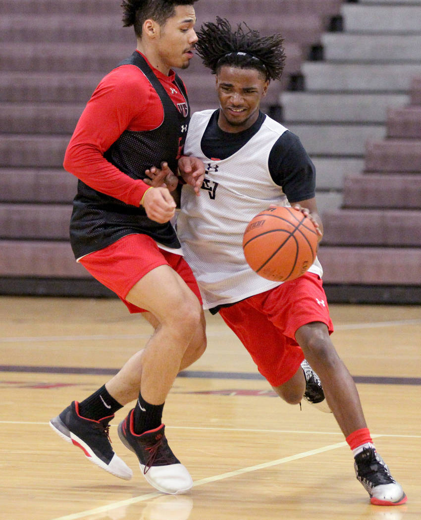 Las Vegas High School point guard Donovan Joyner, left, guards teammate Ronnie Moore during practice Monday, Jan. 8, 2018. The 5-foot-9 Joyner is one of the top players in the Southern Nevada. K.M ...