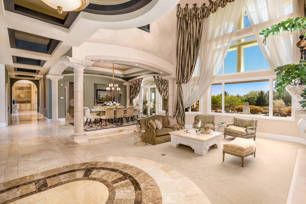 The mansion at 9511 Kings Gate Court in Las Vegas, seen above, sold for $6.5 million in 2017. (Luxury Estates International)