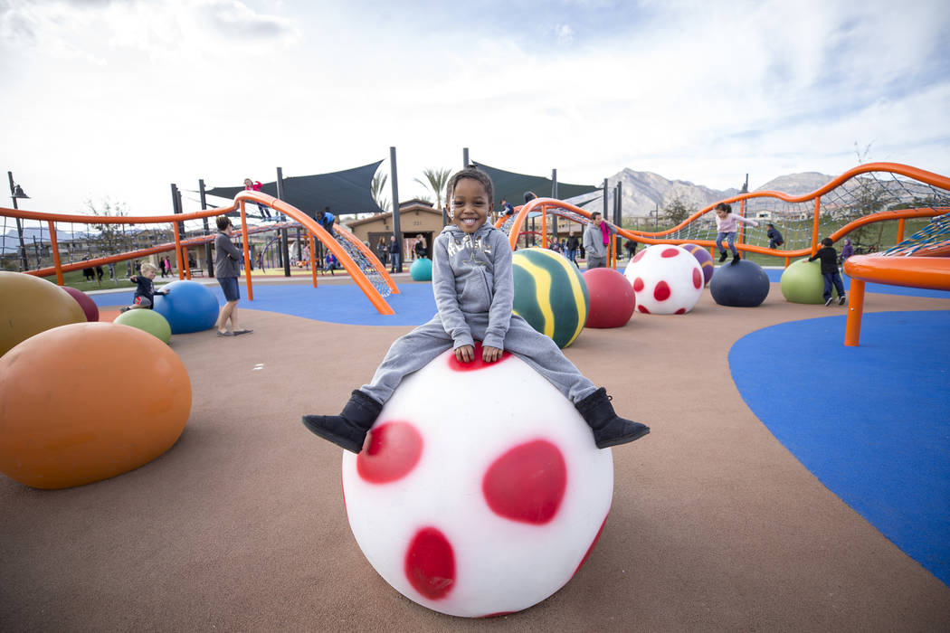 Three-year-old Dashlynn Dees of Las Vegas sits on a colorful climbing ball at Summerlin's Fox Hill Park in The Paseos village neighborhood, Saturday, Jan. 6, 2018, in Las Vegas. Richard Brian Las  ...