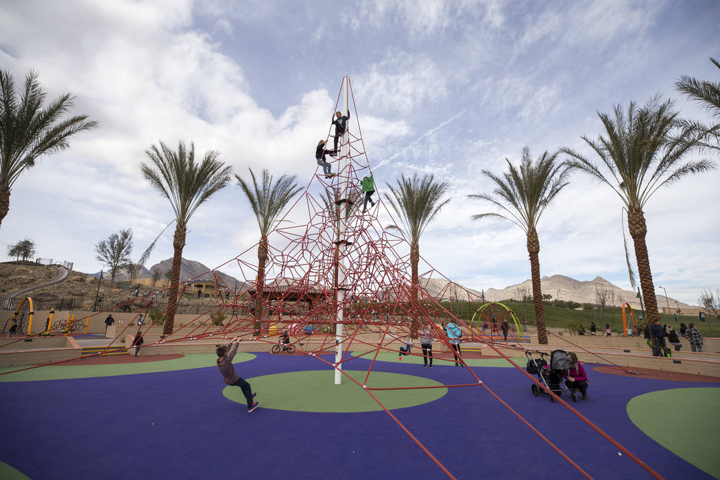 Children play on a 32-foot climbing tower at Summerlin's Fox Hill Park in The Paseos village neighborhood, Saturday, Jan. 6, 2018, in Las Vegas. Richard Brian Las Vegas Review-Journal @vegasphotograph